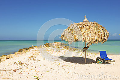Straw umbrella on a tropical beach