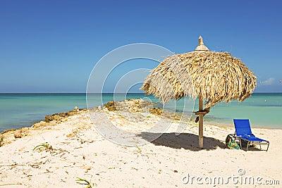 Straw umbrella on a tropical beach
