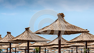 Straw umbrellas on beach
