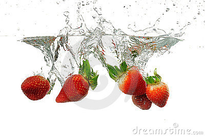 Strawbarries being dumped into water