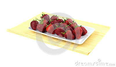 Strawberries on bamboo tablecloth isolated white