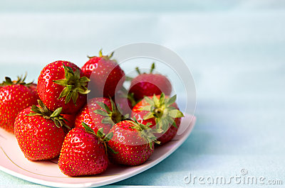 Strawberries on blue