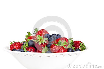 Strawberries and Blueberries in White Bowl Isolated