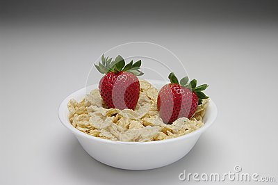 Strawberries with cereal in a white bowl