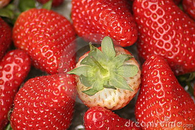 Strawberries and one green top