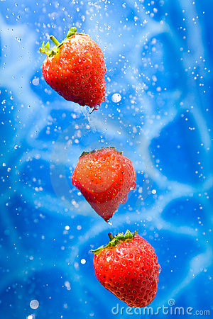 Strawberries in a water splash