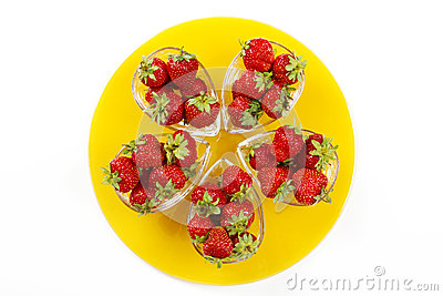 Strawberries on the yellow plate