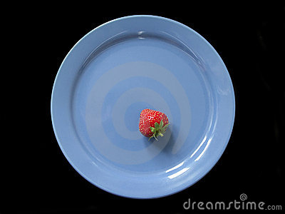 Strawberry on blue plate
