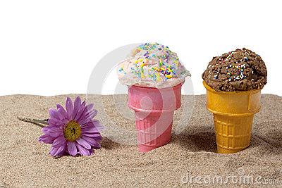 Strawberry and chocolate ice cream in beach sand