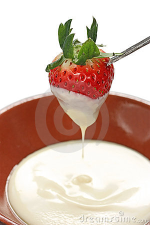 Strawberry dipped in white chocolate fondue