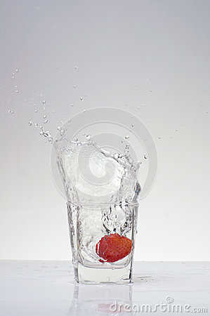 Strawberry fall into the glass