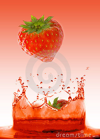 Strawberry falling in juice
