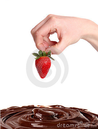 Strawberry in hand with chocolate
