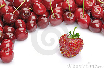 Strawberry and heap of cherries