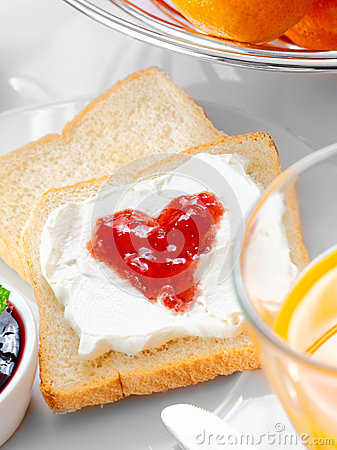 Strawberry jam and cream on bread