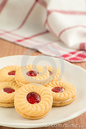Strawberry jam sandwich biscuits on plate