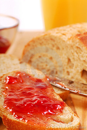 Strawberry jam spread on bread