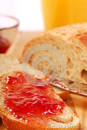 Strawberry jam spread on bread