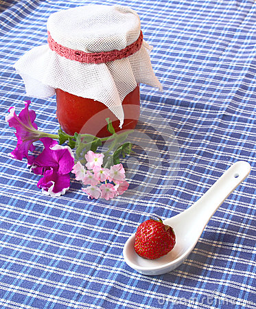 Strawberry and jar of the strawberry cooking