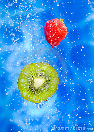 Strawberry and kiwi fruit in a water splash