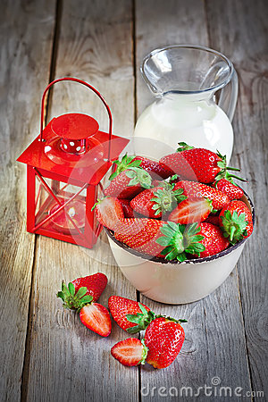 Strawberry, milk and candle lantern Stock Photo
