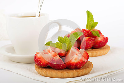 Strawberry with a mint and cup of coffee
