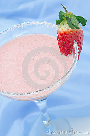 Strawberry smoothie in cocktail glass vertical selective focus
