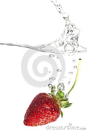 Strawberry splashing into water