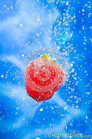 Strawberry in a water splash