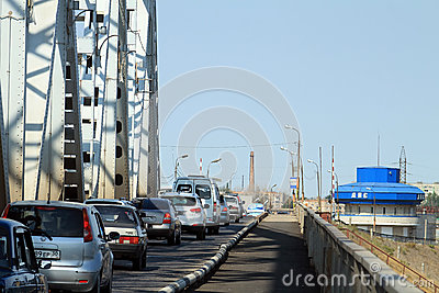 A stream of cars on the old bridge in Astrakhan Editorial Photo