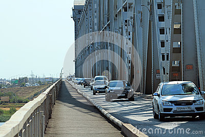A stream of cars on the old bridge in Astrakhan Editorial Image