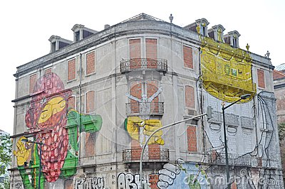 Street art by Blu and Os Gemeos in Lisbon Editorial Photography