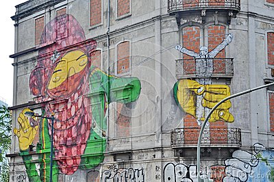 Street art by Os Gemeos in Lisbon Editorial Stock Photo