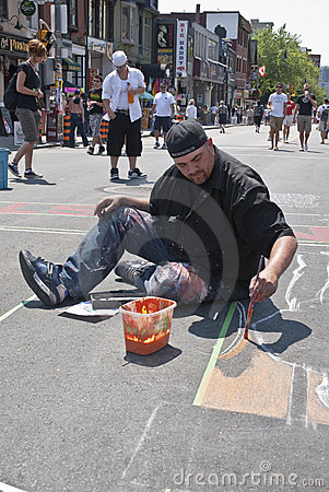 Street artist painting the road at the Toronto Gay Editorial Stock Image
