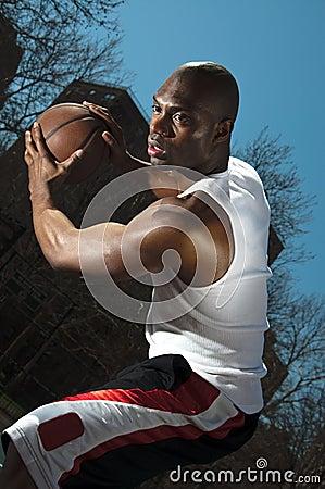 Street basketball player guarding ball