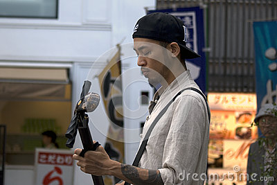 Street busker, Kyoto, Japan Editorial Stock Image