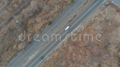 Street. Cars drive on the main road of the suburban community. Street ars drive on the main road of the a suburban community stock video footage
