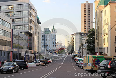 A Moscow street in summer with many buildings and parked cars Editorial Photography