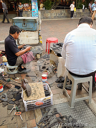 Street cobbler Editorial Image