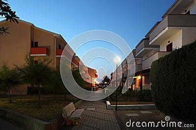 Street between cottages in evening