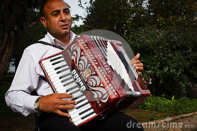 Street entertainer playing the  accordion serenade Editorial Photo