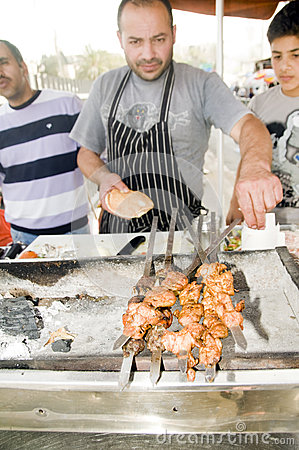 Street food  chicken on hot grill Jerusalem Editorial Stock Photo