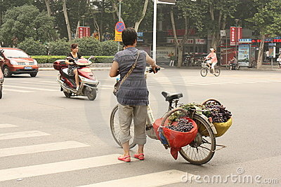 Street fruit seller with fruits on her bicycle Editorial Stock Photo