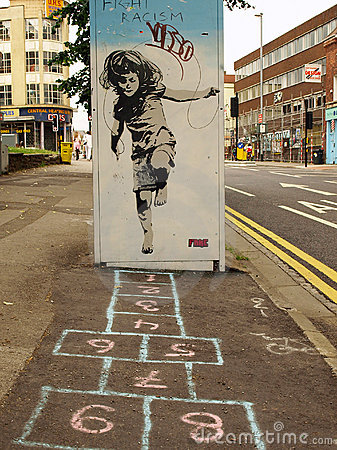 Street Graffiti of a Girl Playing Hopscotch Editorial Photo