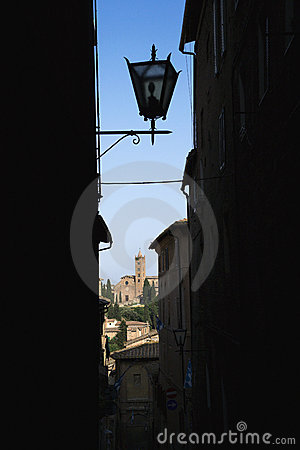 Street lamp in dark alley.