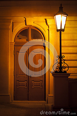 Street lamp at night with door
