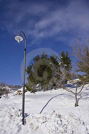 Street lamp in a snowy hill