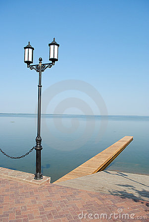 Street lamppost and lake