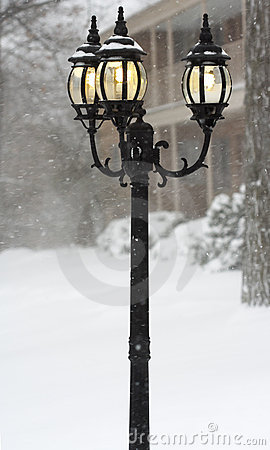 Street lights in a blizzard day