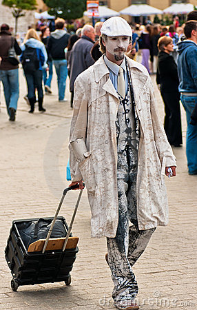 Street mime performer arriving at work in Krakow, Editorial Stock Photo